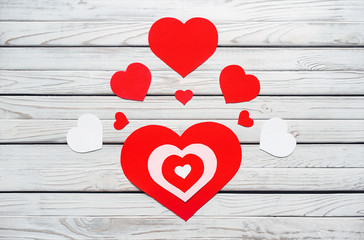 Decorative red and white hearts. View from above. Valentines Day concept. Wooden Background for design to Valentine's Day.