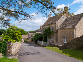 Picturesque street scene in Duntisbourne Abbotts, an idyllic Cotswold village, Gloucestershire, UK