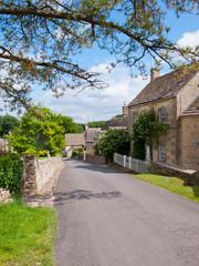 Picturesque street scene in Duntisbourne Abbotts, an idyllic Cotswold village, Gloucestershire, UK