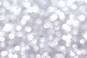 Silver glitter festive background with bokeh lights. Celebration concept for Holidays and...