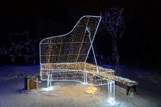 Christmas light decorations glowing piano