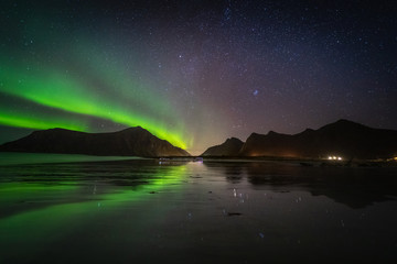 Lofoten aurora above moutains stars sea