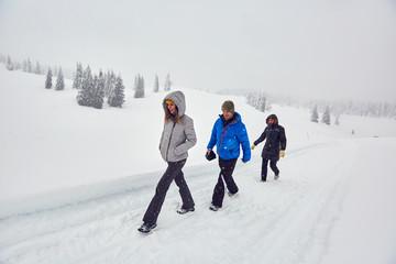 Friends hiking on a snowy trail