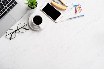 Stylized marble office working desk with smartphone, laptop, glasses and coffee, workspace design, mock up, topview, flatlay, copyspace, closeup