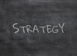Chalk and strategy write on chalkboard background