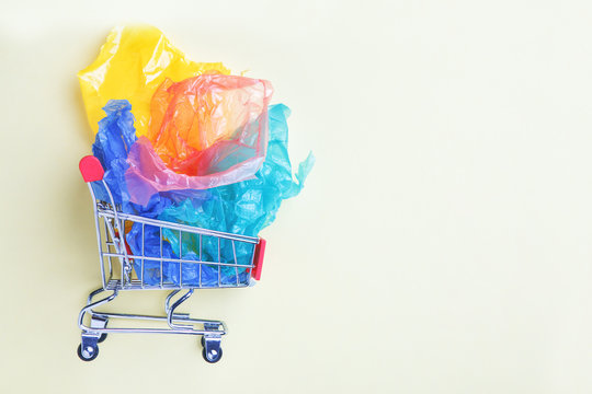 mini shopping trolley full of colorful plastic bags