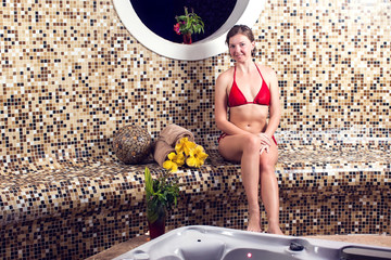 Beautiful spa. Young woman enjoying Jacuzzi and relaxing in a spa center