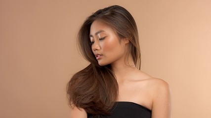 thai asian japanese model closeup portrait with hair covered her face watching aside. straight hair
