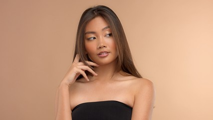 thai asian japanese model closeup portrait with hair covered her face watching aside