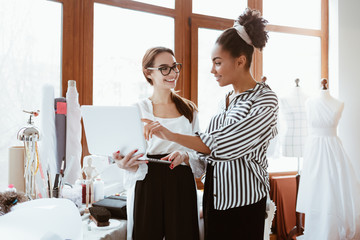 Wall Mural - Two young attractive women working on new design project