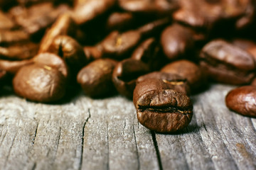Aroma roasted coffee beans, brown background. Soft focus close up.