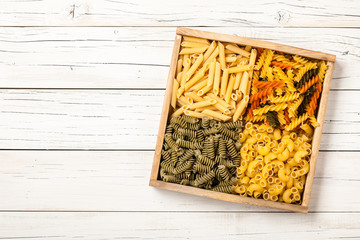 Assortment of pasta in a wooden box