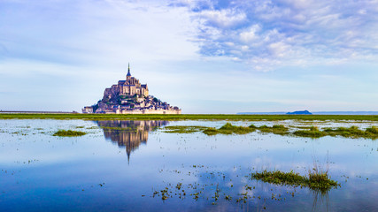 Mont-Saint-Michel reflecting in blue