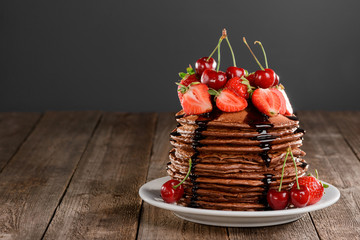 Pancakes with berries and chocolate