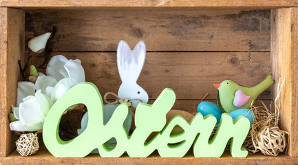 word easter in german language with decoration in a wooden box