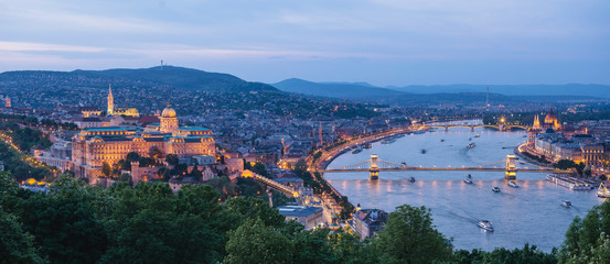 Panorama of Budapest's evening.Capital of Hungary.Beautiful big old town.The photo is made in the dark.The magnificent city is rich in history.City landscape with a wide large river. Golden city.