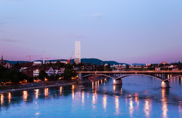 Wettstein bridge lights reflecting in Rhine river