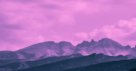 Beautiful mystic mountains sunset landscape. Mystical alpine morning, sunrise in violet and pink colors.