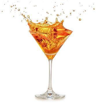 orange cocktail splashing in martini glass isolated on white
