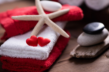 Wellness docoration on valentine's day with towels and stones