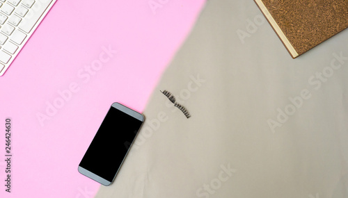Wall mural smart phone and keyboard eyelashes on color paper  flat lay background