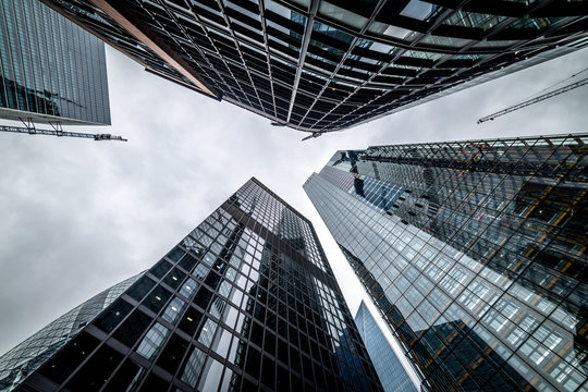 Low angle view of skyscrapers. Looking up perspective. Bottom view of modern skyscrapers in business district. Business concept of success industry