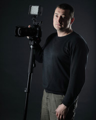 professional photographer with a camera.isolated on black background