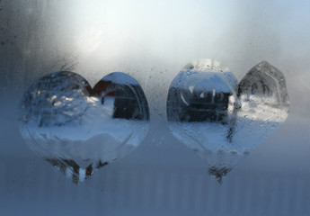 heart drawn on wet glass