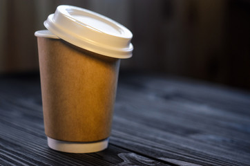 A cup of coffee on the table. Paper cup Wooden table Plastic cap Coffee Expectation. Coffee take away at cafe shop. Concept for mockup, background