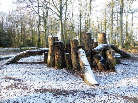 Wooden play area den in winter snow, Chorleywood Common, Hertfordshire, UK