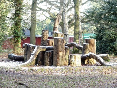 Wooden natural play area den in winter snow, Chorleywood Common, Hertfordshire, UK