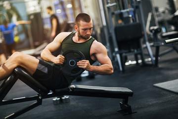 Handsome bodybuilder works out