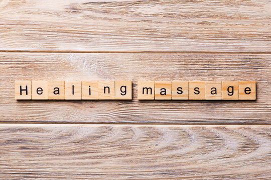 healing massage word written on wood block. healing massage text on wooden table for your desing, concept