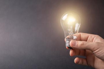 Light bulb in hand lit.