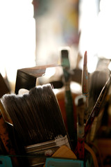 artists paint brushed in tin can