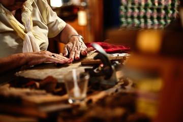 Cuban woman hand rolling cigars