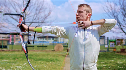 Professional archer prepares to throw arrow