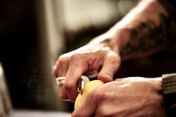 male hands zesting a lemon