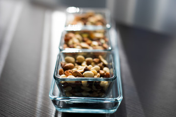 Raisins, peanuts and pistachio in elegant glass bowls