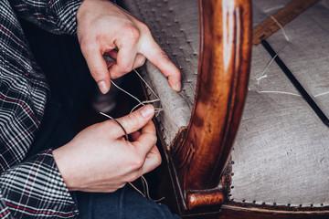 Obraz Upholster restoring an old chair - fototapety do salonu