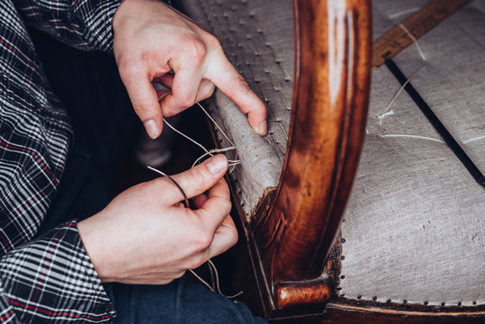Upholster restoring an old chair