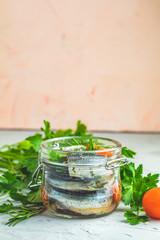 Sardines or baltic herring in glass jar