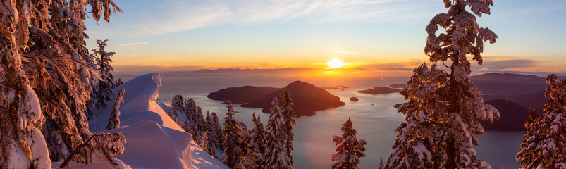 Beautiful Panoramic Canadian Landscape view during a colorful winter sunset. Taken from top of Mnt Harvey, North of Vancouver, BC, Canada.
