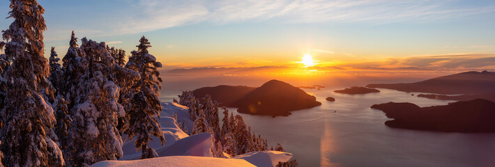 Wall Mural - Beautiful Panoramic Canadian Landscape view during a colorful winter sunset. Taken from top of Mnt Harvey, North of Vancouver, BC, Canada.