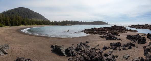 Rocky beach on the Pacific Ocean Coast during a sunny summer day. Taken in Northern Vancouver Island, BC, Canada.