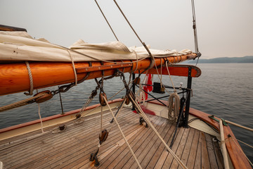 Port Hardy, Vancouver Island, BC, Canada - August 20, 2018: Wooden sailboat parked at a marina during a foggy summer day.