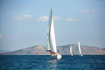 Wall Mural - Sailing boats in the regatta, luxury yachting in Aegean Sea, Greece.