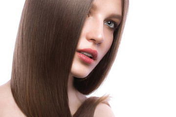 Beautiful brown-haired girl with a perfectly smooth hair, and classic make-up. Beauty face.