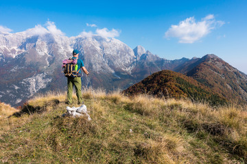 Man hiker watch the landscape of  mountain in autumn from the mountain top.