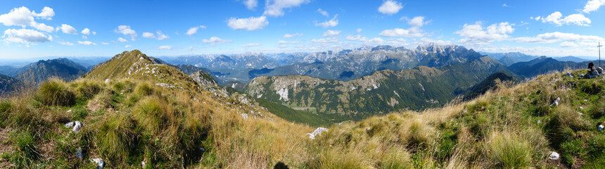 Beautiful mountain panorama on Italian Alps with blue sky and clouds.